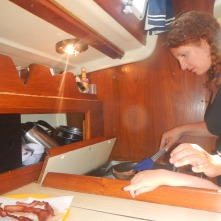 Making a full breakfast during our sail from Port Washington to Sheboygan. With a phantom hand - Claire really wanted that bacon!