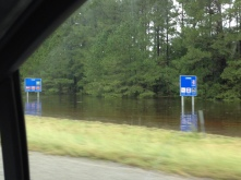 Road signs under water due to record rainfall. Others were bent in half from the wind.